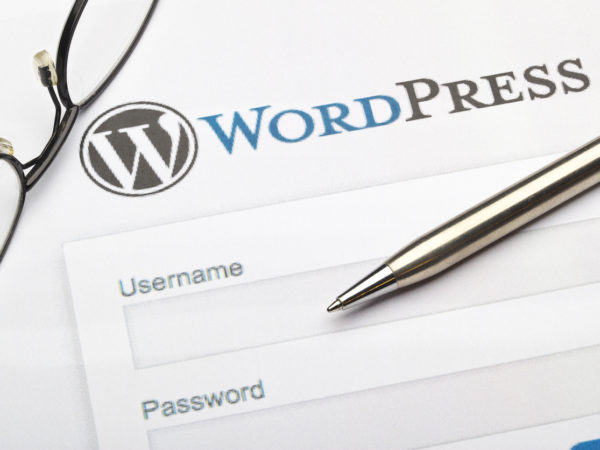 wordpress login screen with pen and glasses